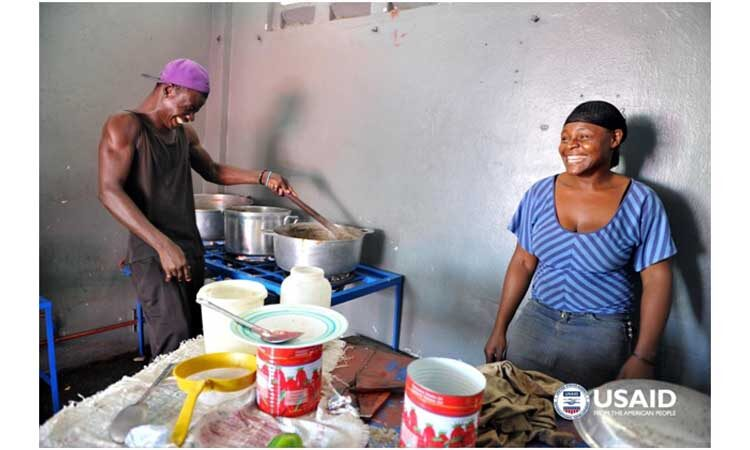 Small business owners in northern Haiti shown here with their new SWITCH LPG stove, supported by USAID. Copyright Maggie Moore/USAID