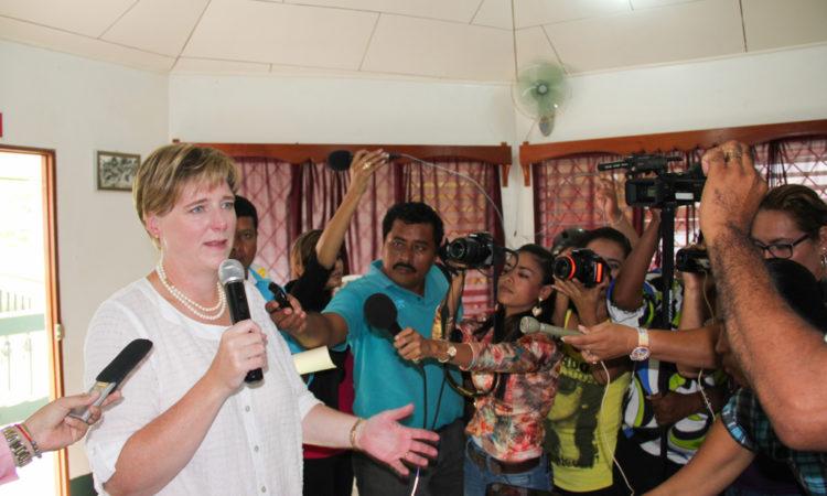 Ambassador Dogu surrounded by journalists