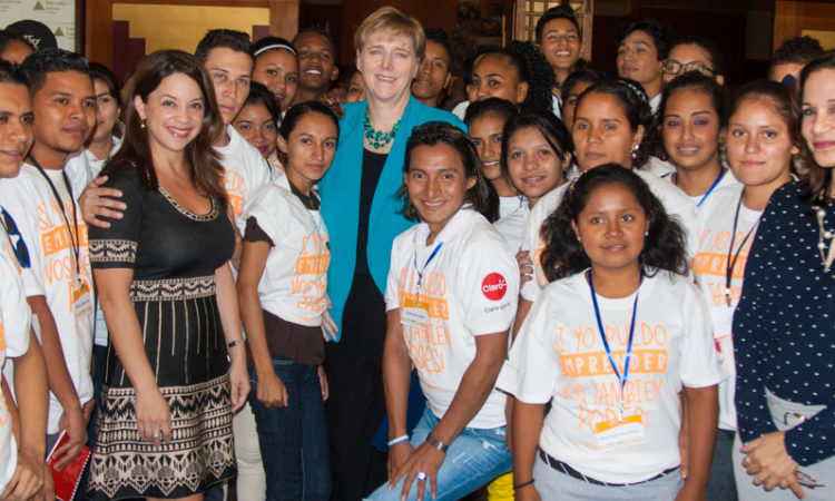 Photo of large group of young people with Ambassador Dogu in the center