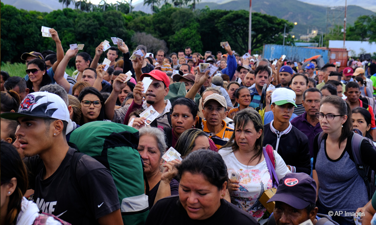 Venezuelans showing their IDs line up to cross the Simon Bolivar international bridge into Cucuta, Colombia.