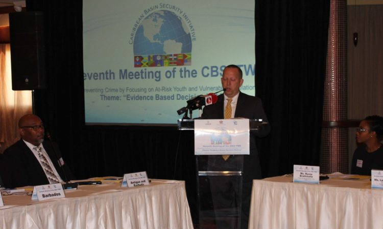 Chargé d'Affaires John W. McIntyre delivering remarks