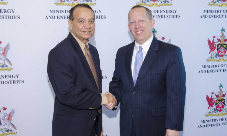 Handshake with Minister of Energy Franklin Khan and Charge´ d'Affairs John McIntyre