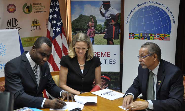 (From right to left) ​MOEYI Permanent Secretary, Dean-Roy Bernard; USAID Mission Director, Maura Barry Boyle; and USAID Program Director, James Burrowes, at the Safe Schools IL Signing.