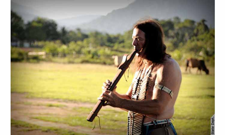 Native American with instrument. (Photo Credit: State Department)
