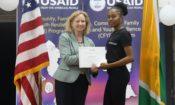 Ambassador congratulates a participant