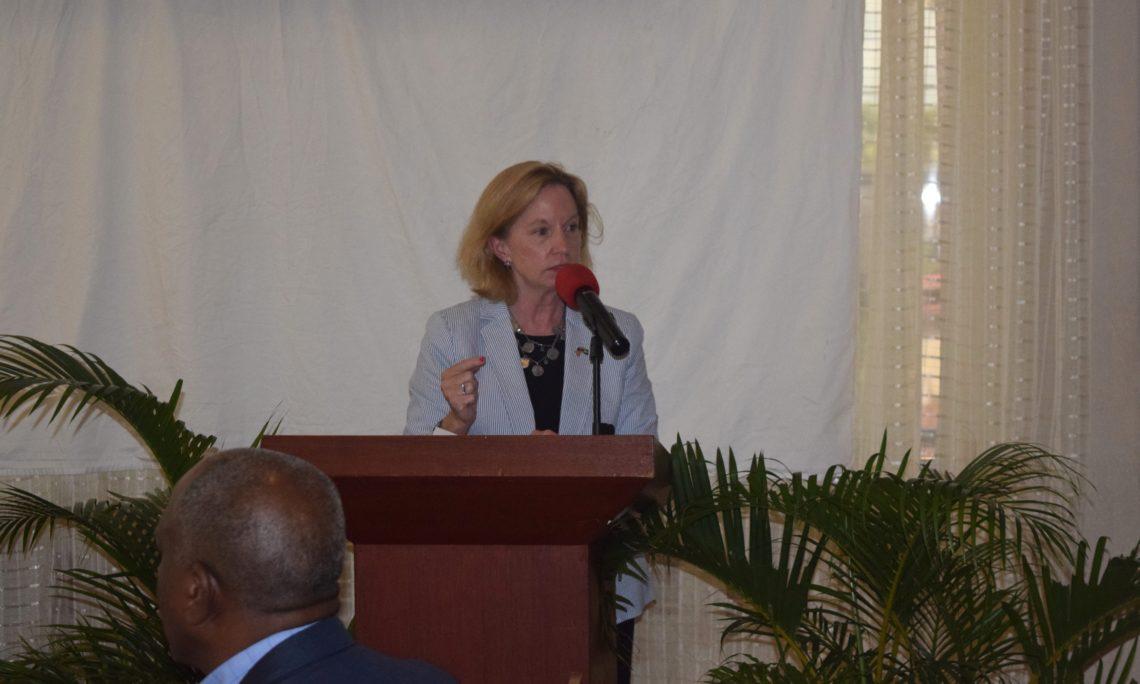 Female speaking at podium