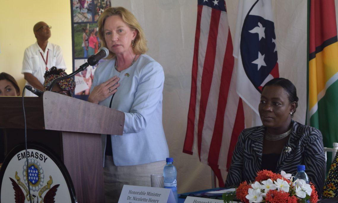 Female standing at podium