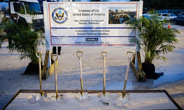 Four shovels standing upright in dirt