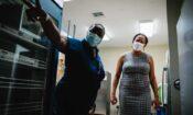 Nurse Ruth Bastian, National Immunization Coordinator (left) and U.S. Chargé d'Affaires Usha Pitts discuss the COVID-19 pandemic response.