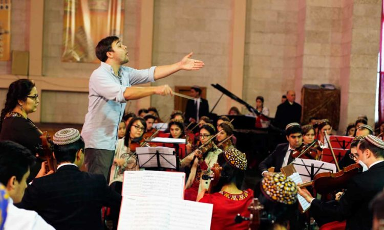American conductor and musician Derek Beckvold leads a rehearsal in advance of the holiday concert with the students of the National Conservatory of Turkmenistan