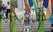 An American performer showcases Native American traditional dress and dances in Ashgabat.