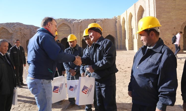 Ambassador Allan Mustard meets with the workers involved in the Dayahatyn Cultural Preservation Project