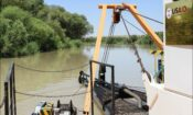 The dredger removing sediment from the Murghab River (June 2020)/ Photo credit: Arif Mamedov for the Smart Waters program