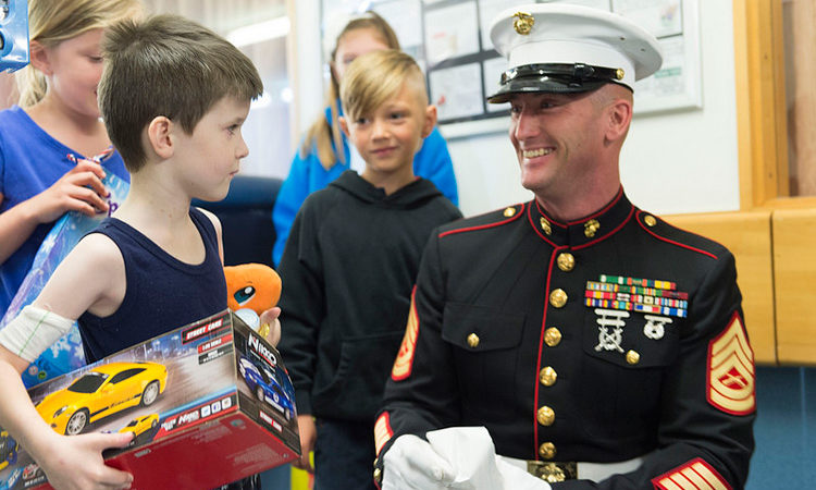 "Detachment Commander Hammer says that the Marine Security Guard program, which protects U.S. Embassies around the world, enabled the Toys for Tots program to reach out ""in pretty much every country in the world."" Photo credit: U.S. Department of State."