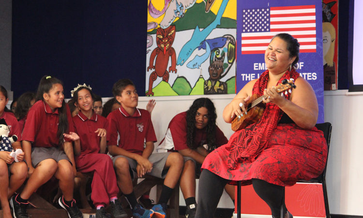 2016 Arts Envoy Paula Fuga performing Hawaiian mele for keiki at Sylvia Park School. Photo credit: U.S. Department of State.