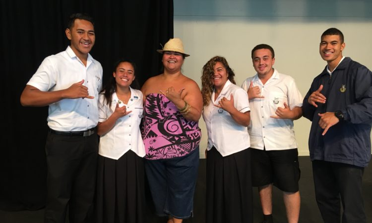 Paula Fuga flashing the Shaka with Otahuhu prefects
