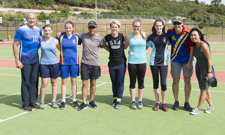 Ambassador Gilbert and Lori Lindsey have a kick around with the team at Wellington Girls' College. Photo credit: U.S. State Department.