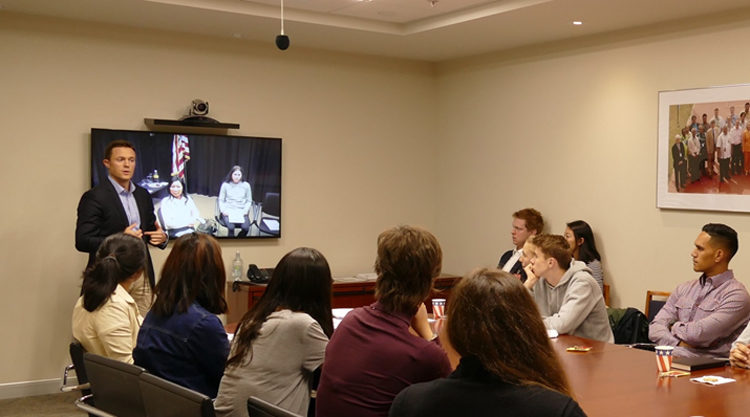 Foreign Service Officer Kennon Kincaid welcomes students at the U.S. Consulate. Photo credit: U.S. Department of State.
