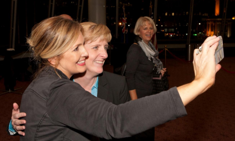 """GERM Magazine's Jennifer Niven and U.S. Consul General Melanie Higgins bond over selfies"". Photo credit: U.S. Department of State."