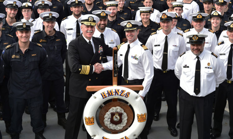 United States Commander Pacific Fleet, Admiral Scott Swift, centre left, with Commanding Officer of HMNZS Te Kaha, Commander Steve Lenik, flanked by the ship's officers and crew at Devonport today. Photo credit: NZ Defence Force.
