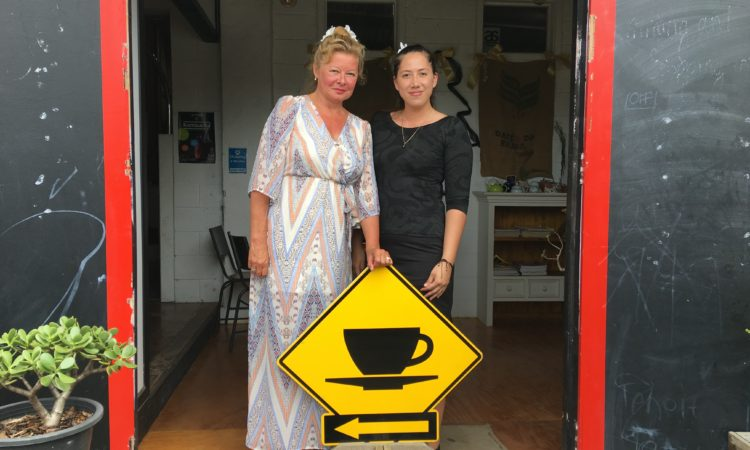 Ana File-Heather (right), owner of Red Door Coffee Bar and Unique Island Streetwear, with Mrs. Gail Brown. Photo credit: Ana File-Heather.