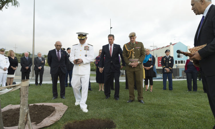 Admiral Harris carries a Mauri stone to it's resting place at the site of the U.S. Memorial