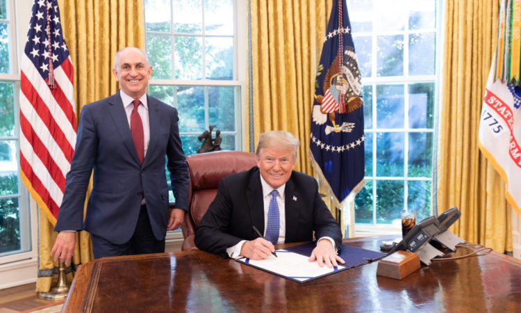 U.S. President Donald Trump signing the KIWI Act (pictured with White House Deputy Chief of Staff for Policy Coordination, Chris Liddell). Photo credit: Joyce N. Boghosian.