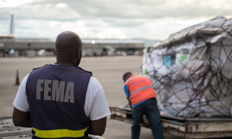 SAN JUAN, Puerto Rico — Tim Ross, an official with the Federal Emergency Management Agency, oversees an offloading operation bringing goods from an Amerijet cargo aircraft at the Luis Muñoz Marín International Airport in San Juan, Nov. 18, 2017. New Zealand recently shipped 18 pallets of food to the island for distribution by the Warfighter Disaster Response Team working through the Federal Emergency Management Agency. The food will be given out to families still in need following the destruction of Hurricane Maria. (U.S. Army photo by Staff Sgt. Evan Lane).