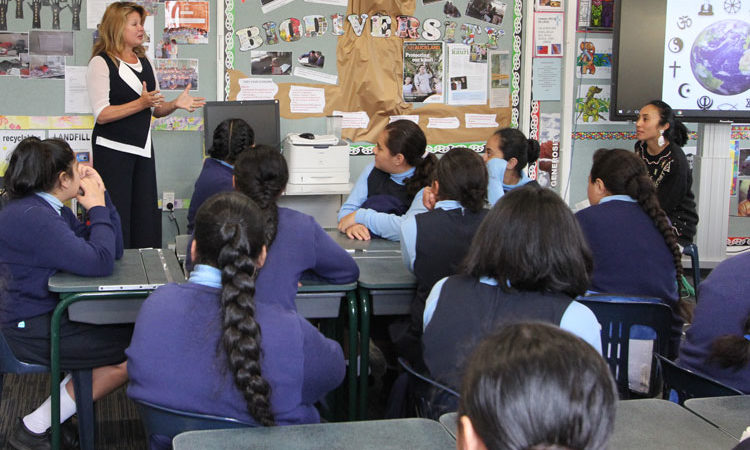 Mrs Brown speaking to a class at Auckland's St Joseph's school alongside Nora. Photo credit: U.S. Department of State.