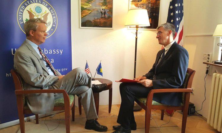 Ambassador Delawie with RFE Journalist