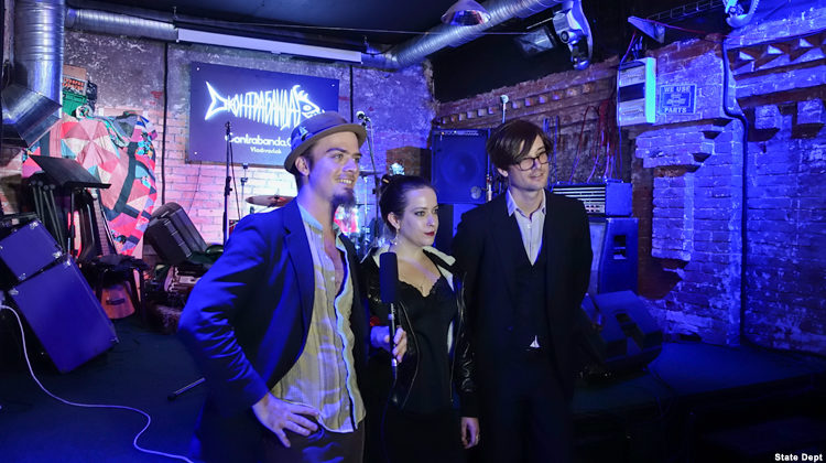 Three musicians give an interview.