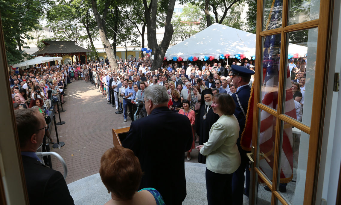 Ambassador John F. Tefft speaking in front of a large crowd