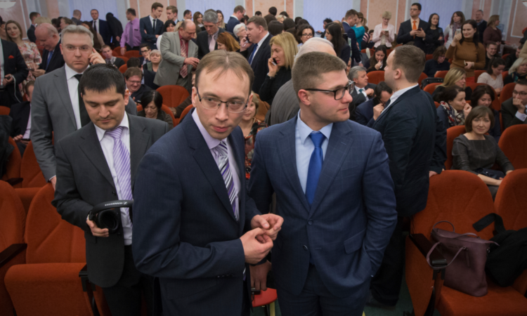 Members of Jehovah's Witnesses wait in a court room in Moscow, Russia, April 20, 2017. (AP Photo)
