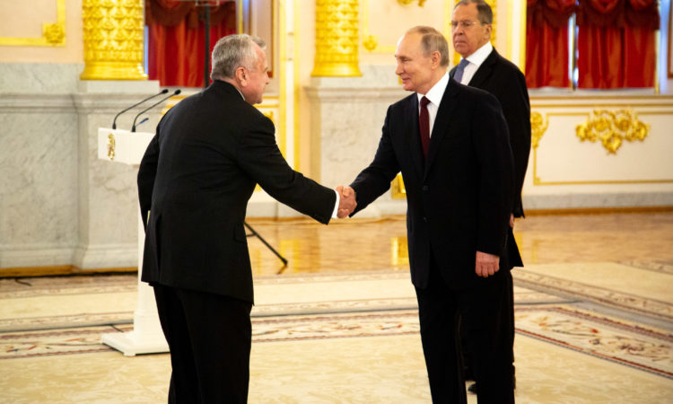 Ambassador Sullivan and Russian President Vladimir Putin shake hands as Russian Foreign Minister Sergei Lavrov, right, attends a ceremony to receive credentials from newly appointed foreign ambassadors to Russia in Kremlin, in Moscow, Russia, Wednesday, Feb. 5, 2020