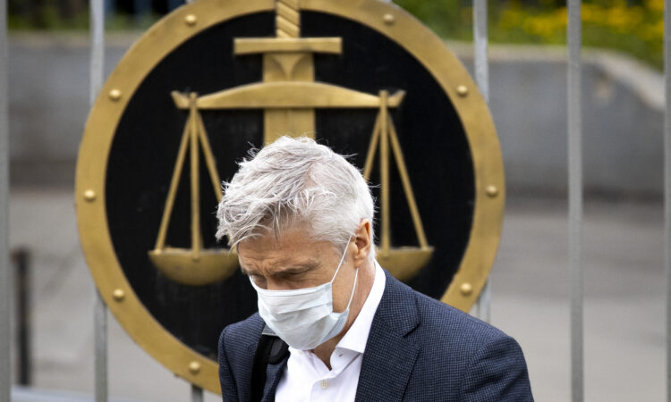 Founder of the Baring Vostok investment fund Michael Calvey, wearing a face mask to protect against coronavirus, arrives to attend a hearing on extending his house arrest in Moscow, Russia. Calvey has been under house arrest since April 2019 - on fraud charges widely seen as controversial. (AP Photo/Alexander Zemlianichenko)