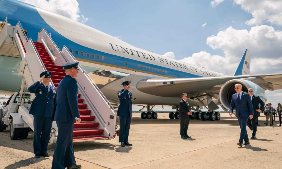 President Biden walking towards the boarding stairs of Air Force One