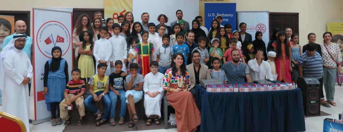 Group of students and adults in a classroom. (Photo Credit: State Department)