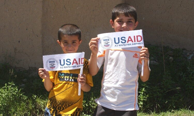 Two boys holding logo flags (Embassy Image)