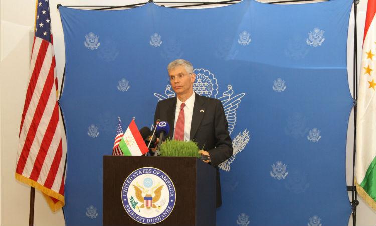 Man standing behind podium. (State Dept.)