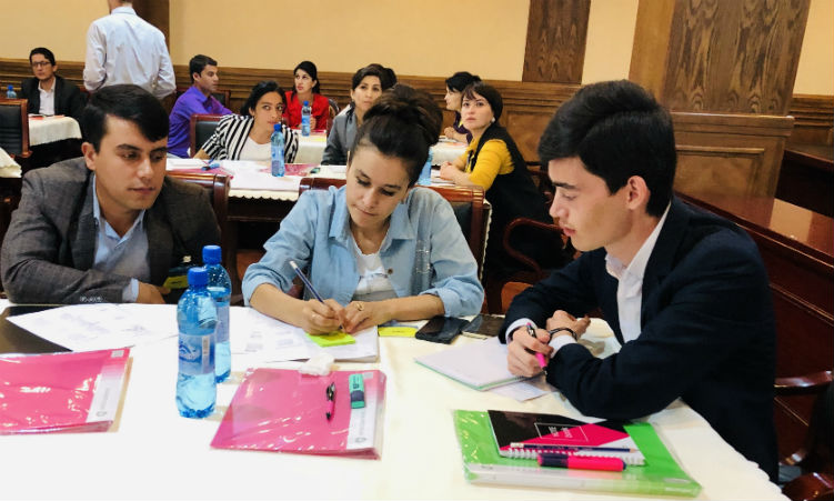 Students seated at tables. (Embassy Image)