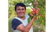 Man holding fruit. (Embassy Image)