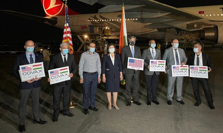 Group of people holding signs. (Embassy Image)