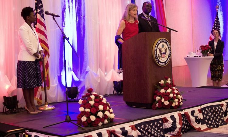 Ambassador Erica J. Barks-Ruggles giving her Independence Day Speech. Standing beside is Minister Francois Kanimba.