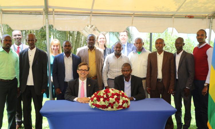 U.S. Ambassador Peter Vrooman, Director General for the Rwanda Cooperative Agency Professor Jean Bosco Harelimana, and this year's new ASG grant recipients .