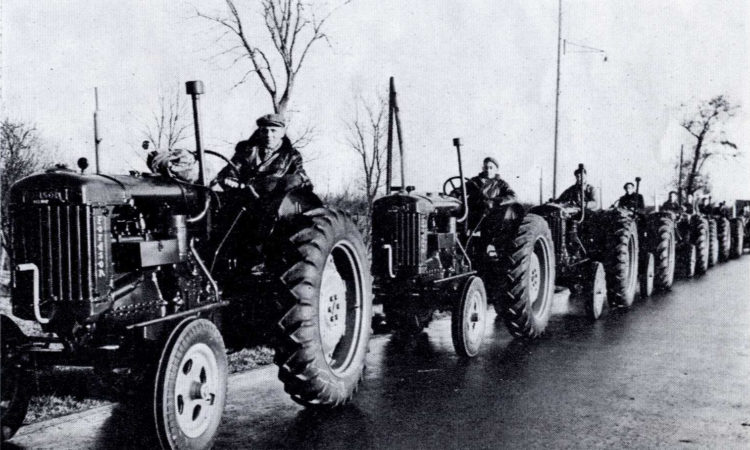 A long line of tractors forms an encouraging sight