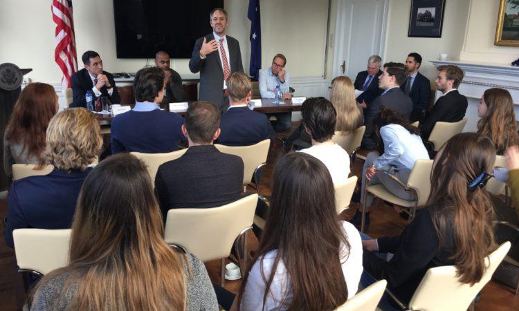 CG McCawley greets students and panelists for a cyber security and entrepreneurship event in Amsterdam.