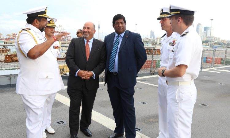 Foreign Minister Ravi Karunanayake and Sri Lanka Navy Commander Ravindra Wijegunaratne joined U.S. Ambassador Atul Keshap to express appreciation to USS Lake Erie Capt. Darren McPherson and his crew.