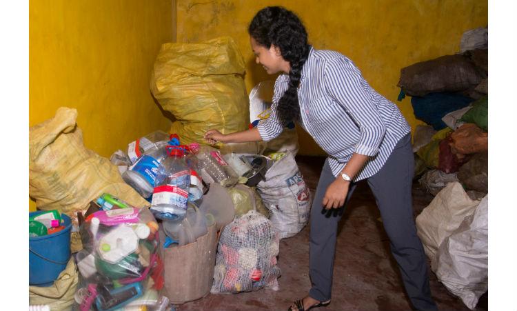 Lady touching plastic bottles. (Embassy Image)