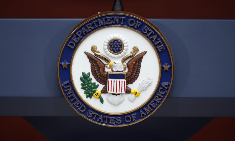 The seal of the State Department is seen before Secretary of State John Kerry speaks at the Washington Passport Agency, Tuesday, July 12, 2016 in Washington. (AP Photo/Alex Brandon)