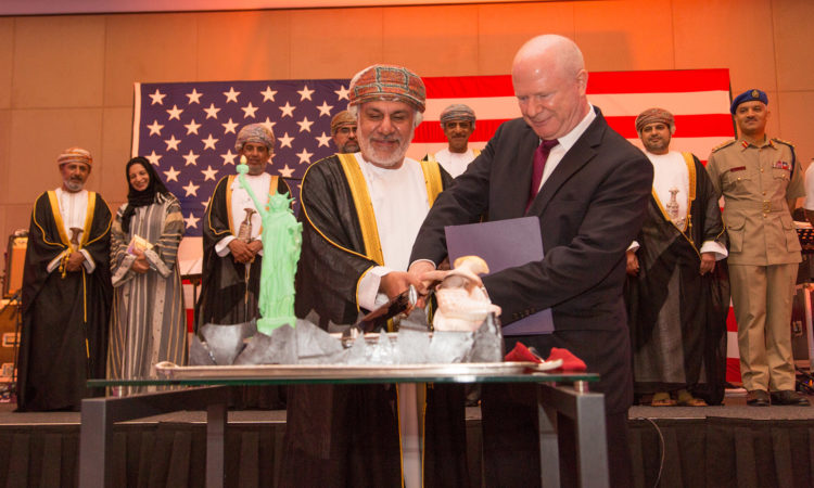 Ambassador Marc J. Sievers and Guest of Honor, the Honorable Dr. Sheikh Al Khattab bin Ghalib bin Ali Al Hinai, cut the cake to inaugurate the U.S. Embassy Muscat National Day Celebration